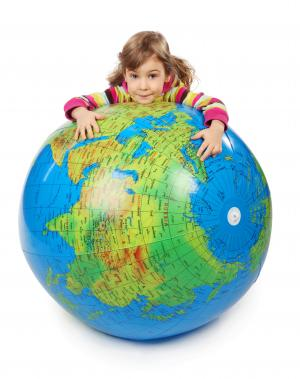 girl leaning on inflatable globe